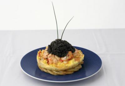 Omelette da Boisdale - Le uova sono di una rara specie il Gabbiano Reale, che per altro depone solo nel periodo primaverile. All'interno granchio, aragosta, asparagi e tartufo. Servita su letto di Cornetto di Bamberga e condita con olio extravergine di oliva Lambda (Grecia) e 30gr di Caviale Beluga - 249euro.